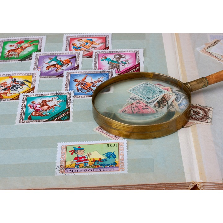 Stamps and magnifying glass