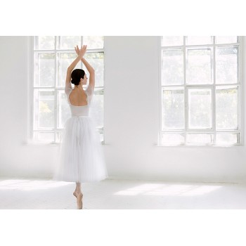 Ballerina in a white studio
